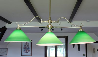 brass pool light with 3 green shades