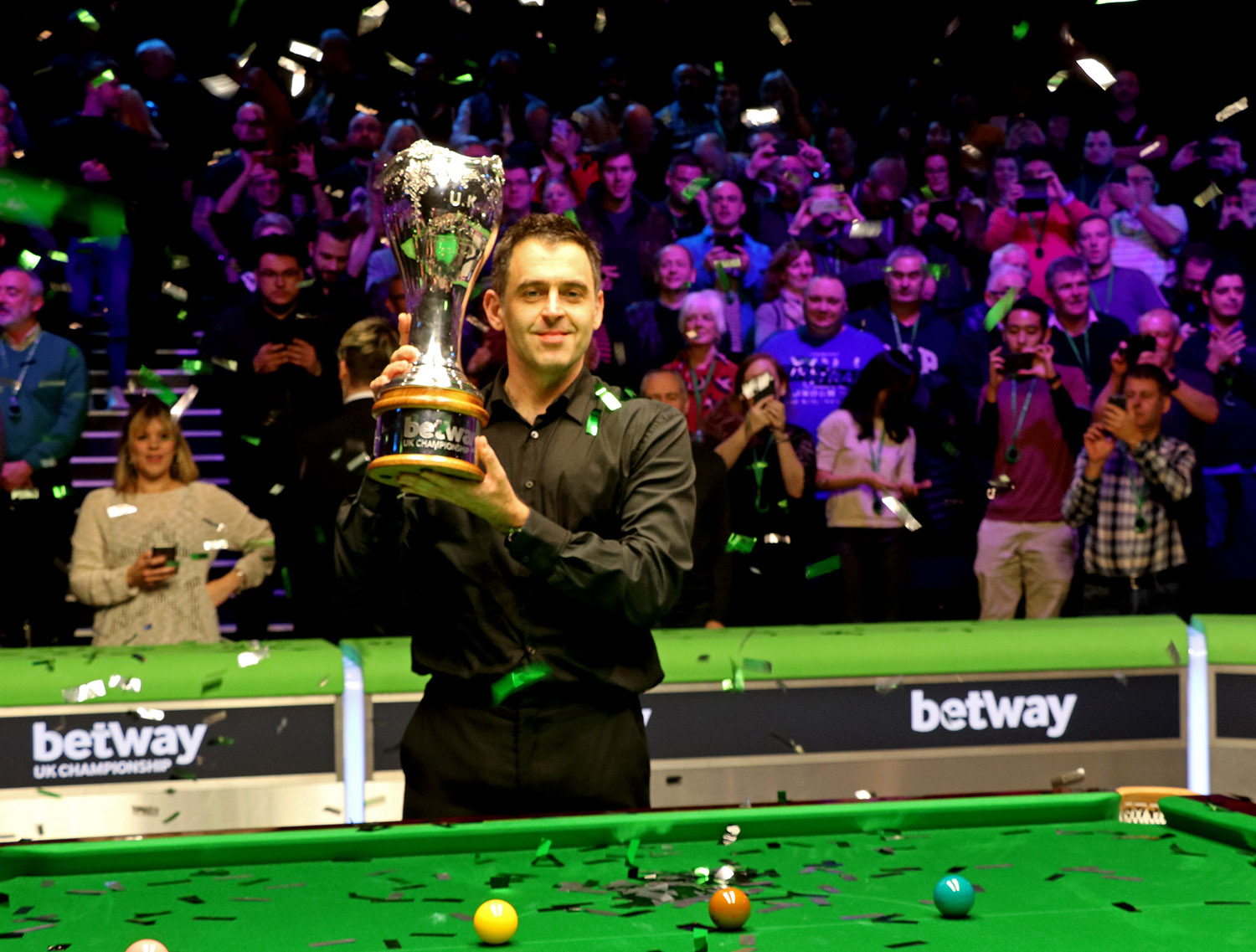 Ronnie O'Sullivan lifts the trophy as he defeats Mark Allen 10-6 in the final of the snooker Betway UK Championship 2018