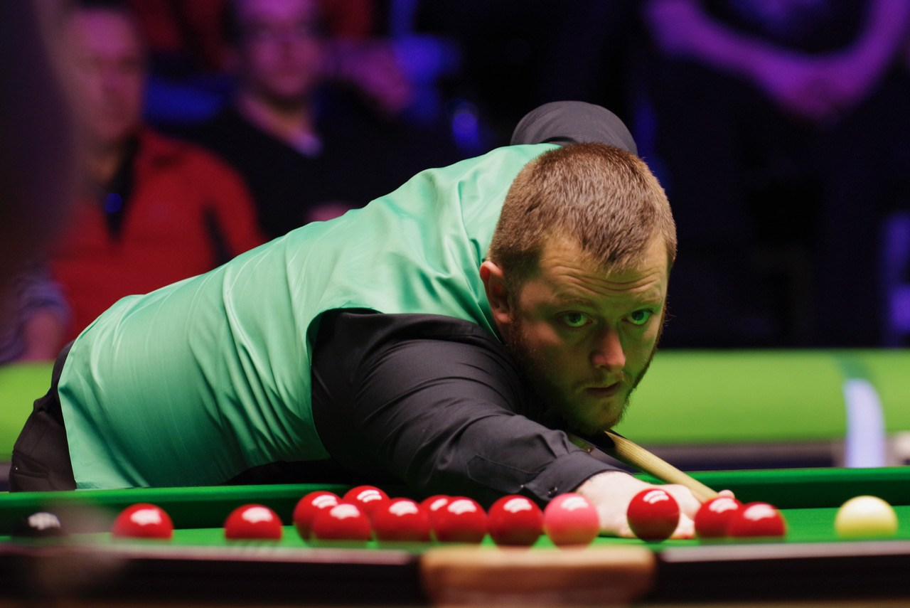 Mark Allen eyeing up the snooker table as he is defeated 10-6 by Ronnie O'Sullivan in the final of the Betway UK Championship 2018