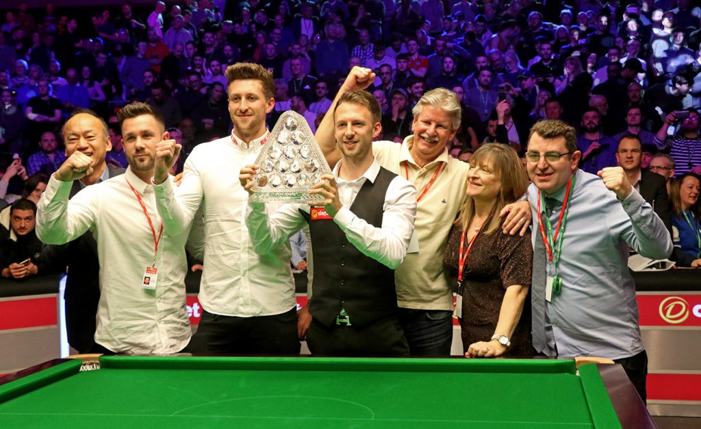 Judd Trump celebrates with his family after lifting the 2019 Masters trophy, defeating Ronnie O'Sullivan in the final