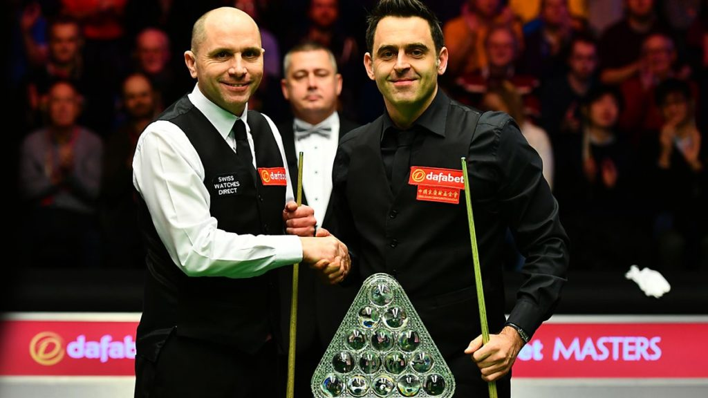 O'Sullivan is pictured with fellow professional Joe Perry after defeating him in the 2017 Masters final.