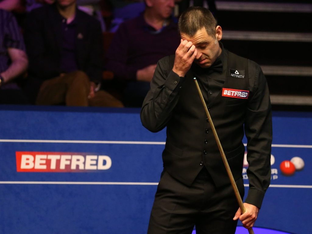 The pre-tournament favourite Ronnie O'Sullivan watches on in despair after losing 10-8 to James Cahill in the first round of the World Championship.
